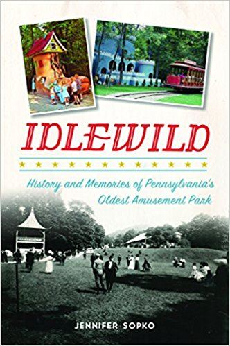 "Book Cover of ""Idlewild,"" with an historic photo of park patrons"