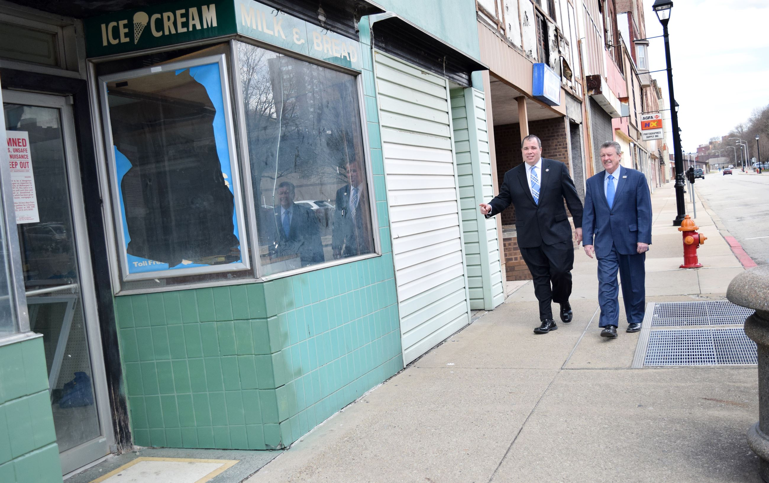 Mayor Cherepko and Senator Brewster walk along Fifth Avenue